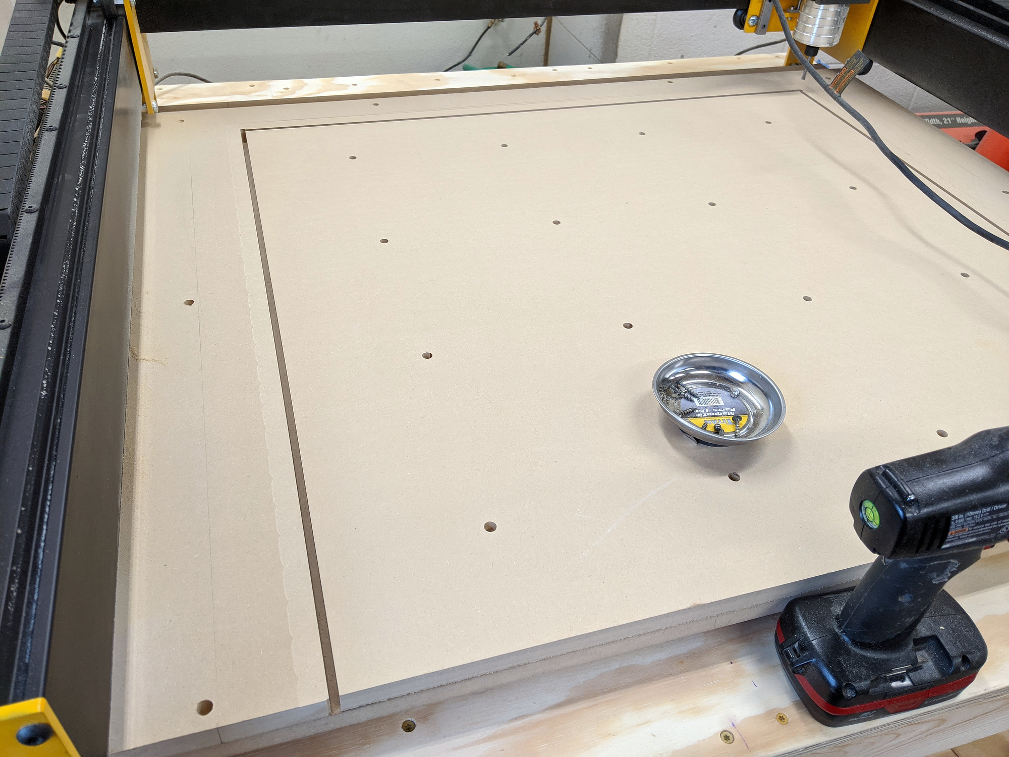 Wasteboard cut out, drilled and fastened